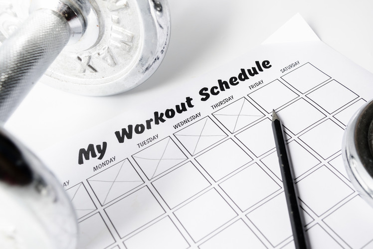 Completing a set number of workouts a week