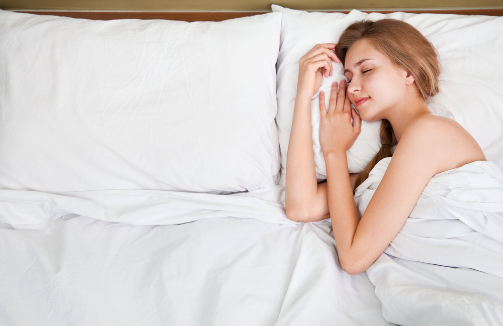 stay cooler at night by sleeping alone on hot nights