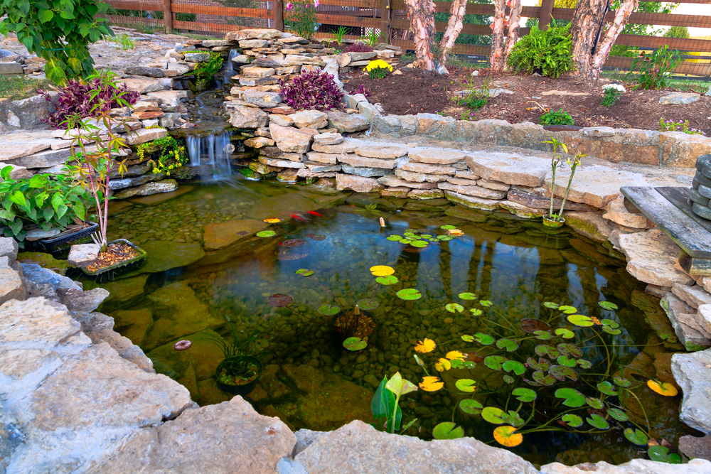 How to build an outdoor waterfall 6 simple steps for Natural koi pond design
