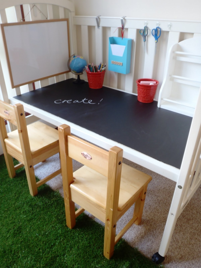 Turn an old baby crib into a children's play table