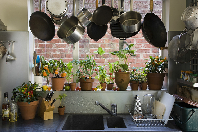 Space Saving Ways to Store Pots and Pans is to Hang them on a rack