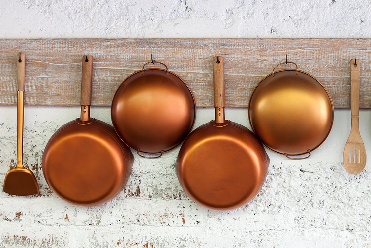 Add hooks to the wall to store your pots and pans