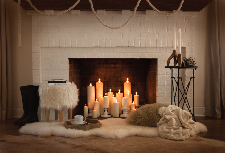 add candles to your unused fireplace for coziness