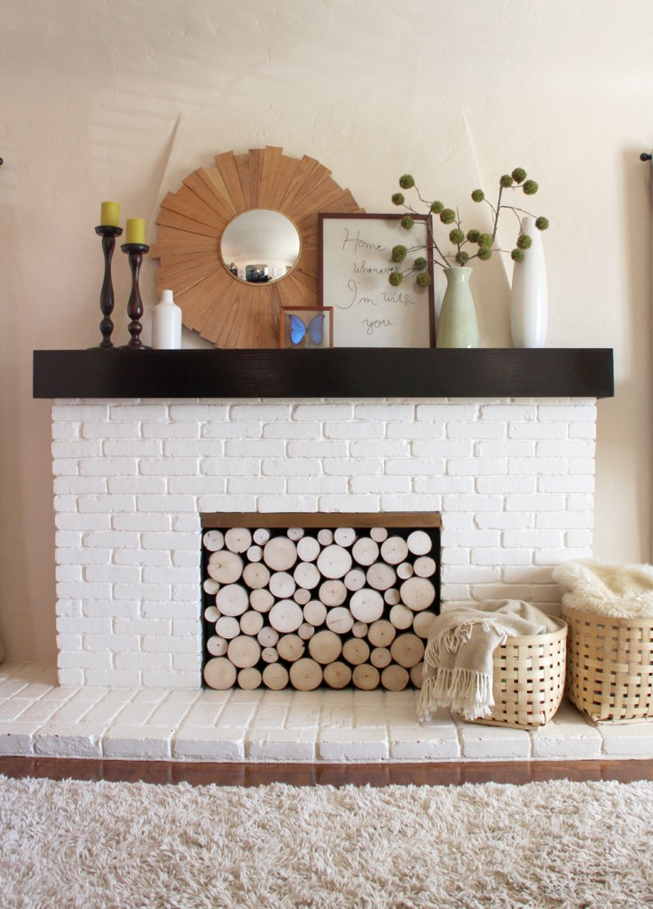 Firewood stacks are one of the simplest ideas for decorating an unused fireplace