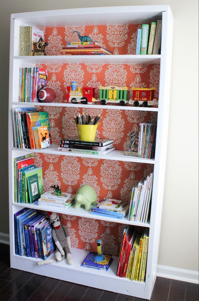 wallpapered bookshelf