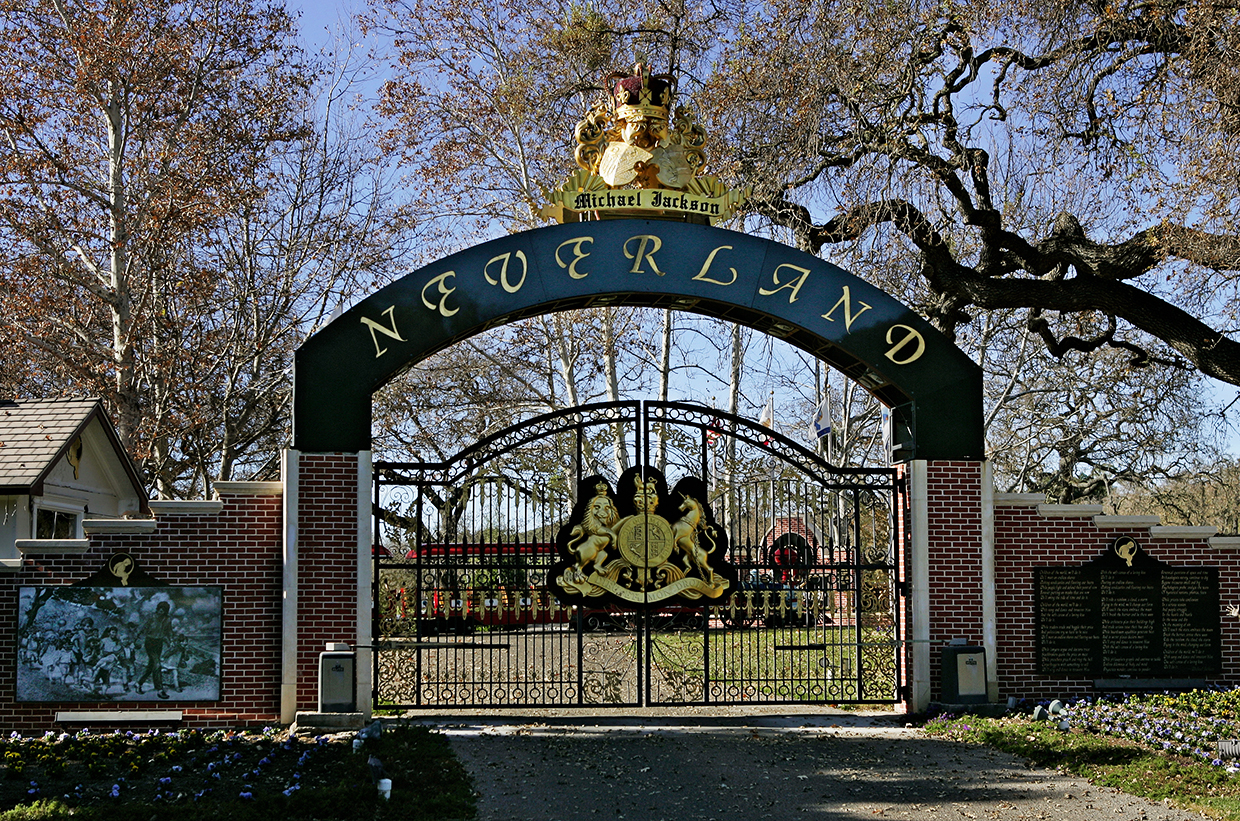 ** FILE ** The entrance to pop star Michael Jackson's Neverland Ranch home is seen in this Dec. 2004 file photo, in Santa Ynez, Calif.  A court filing says Jackson's Neverland Ranch will be put up for sale at a public auction on March 19, 2008  unless the pop star pays the more than $24 million he still owes on the property. Financial Title Co. filed the notice of trustee's sale with Santa Barbara County Superior Court on Tuesday Feb. 26, 2008  (AP Photo/Mark J. Terrill, File)