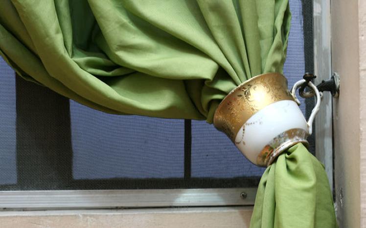 Use teacups as curtain tiebacks