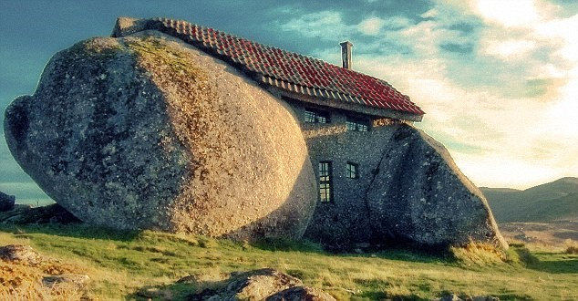 house between 2 rocks