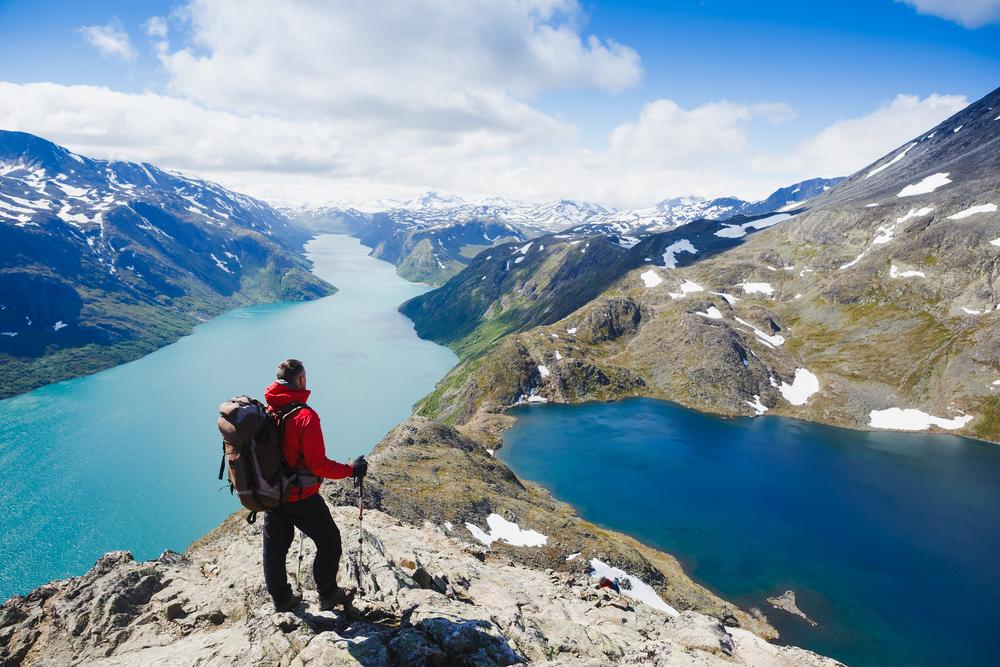 man walking over mountains