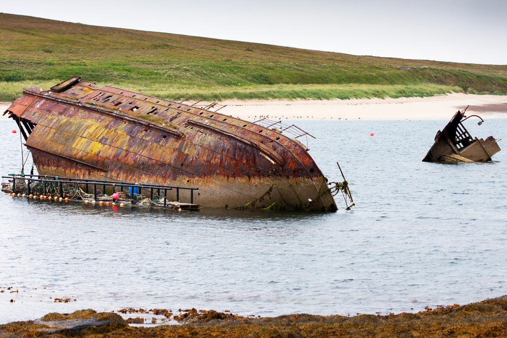 World War II boat intentionally sunk to protect the natural harbour of Scapa Flow, South Ronaldsay, Orkney, Scotland, UK