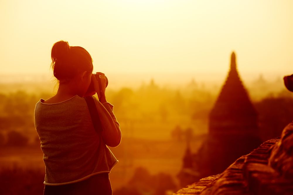 female traveler photographing temples