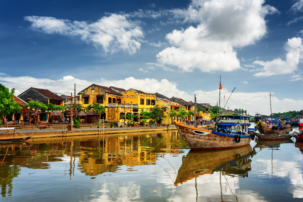 Hoi An yellow buildings reflecting in river