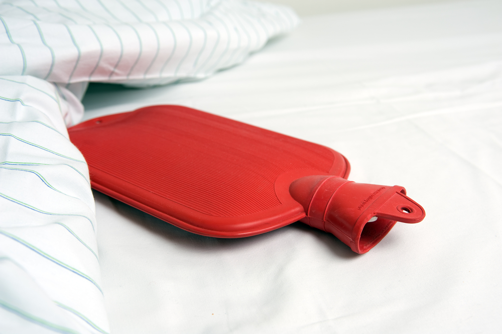 frozen hot water bottles are a good way to keep your bed cool