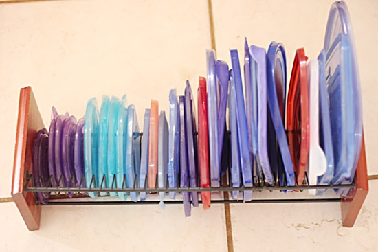 Repurpose an old CD rack to store plastic storage lids
