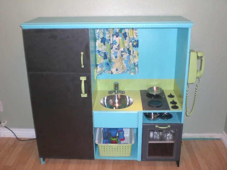 Construct a play kitchen out of an old entertainment center