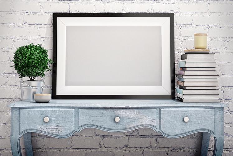 Add art behind desks or utilitarian pieces