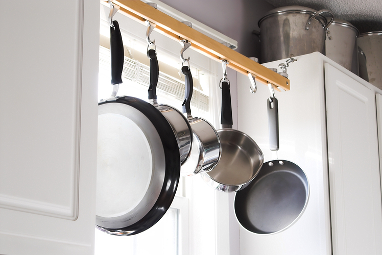 Store your pots and pans in front of the window