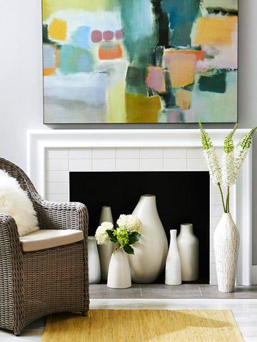 Jars and vases complement an unused fireplace well