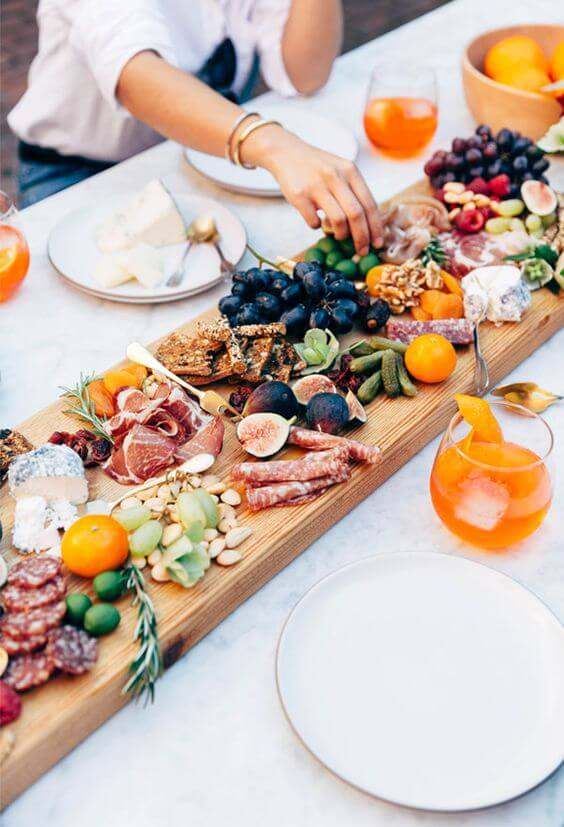 Pass Appetizers at a garden party