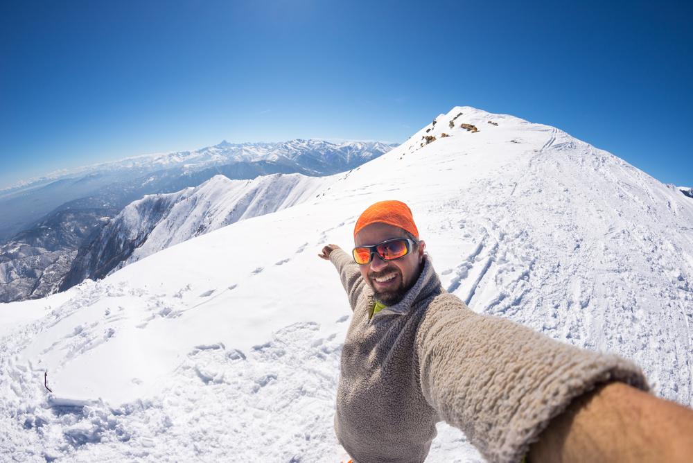 man taking selfie in italian alps